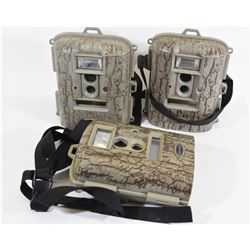 Three Moultrie Trail Cams