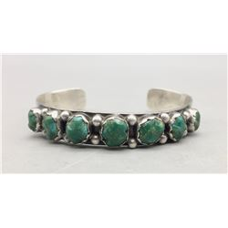Seven Stone Carved Turquoise Bracelet