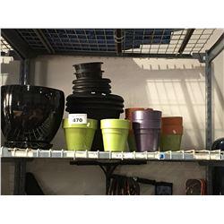 SHELF LOT FULL OF CERAMIC & PLASTIC PLANTERS