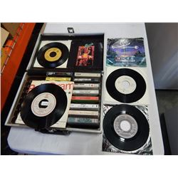 VINTAGE CASSETTE CASE W/ CASSETTES AND 6 ROCK AND ROLL 45s