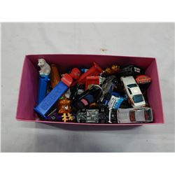 BIN OF PEZ DISPENSERS AND TOY CARS