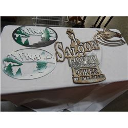 LOT OF 4 METAL SIGNS, CANUCKS LOGO, SALOON, AND OTHERS