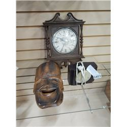 2 VINTAGE CLOCKS AND 2 WOOD CARVED MASKS