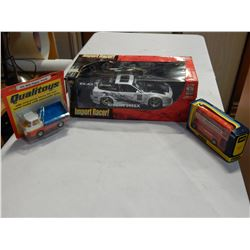 CORGI 702 SIDE TIPPER TRUCK AND 469 LONDON ROUTEMASTER BUS IN BOX AND DIE CAST NISSAN RACE CAR