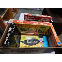 BOX OF BOARD GAMES AND DVDS