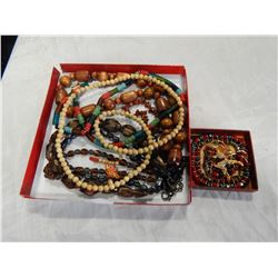TRAY OF BEADED JEWELRY AND GOLD TONE BROACH