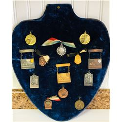 PLAQUE DISPLAYING 13 DOMINION MARKSMEN MEDALS