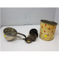 TWO KITCHEN SIFTERS AND MEASURING CUPS