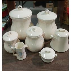 SEVEN PIECE CROCKERY CANISTER SET (CREAMER, TEAPOT, ETC.)
