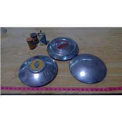THREE HUBCAPS AND THREE SMALL TINS (2 WHIZ TINS)