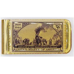 GOLD TONED MONEY CLIP WITH POSTAGE STAMP DESIGN