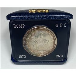 1973 Silver Dollar in a Blue Case with Gold Crest