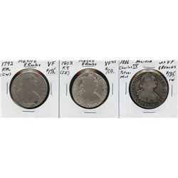 Three 8 Reales coins from Mexico