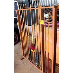 Multiple Misc Pool Cue Sticks in Wooden Rack