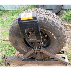 All Terrain 33x12.50R15L Tire on XRC Tire Carrier Stand