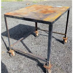 Black Metal Shop Table on 4 Wheels