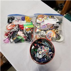 LARGE BAG OF KEY CHAINS, LARGE BAG OF PINS, AND TIN OF PINS