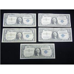 Five $1 1957 Blue Seal Silver Certificates.