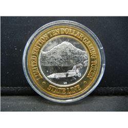 State Line Nevada $10 (.999) silver gambling token.   In capsule.