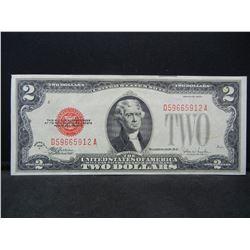 1928F $2 Red Seal.  Nice AU.  Scarce.