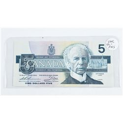 1986 - $5 Bill - Thiessen & Crow - Serial Number : FNS5371911. UNC.Â