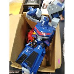 Box of action figures and transformer