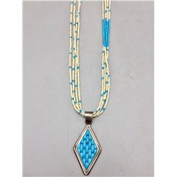 Carved Turquoise Pendant with Heishi Necklace