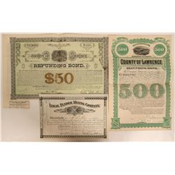 Three Dakota Stocks and Bonds: Legal Tender MC and two Lawrence County Bonds  (110937)