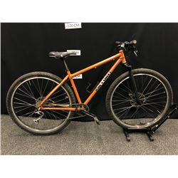 ORANGE ON ONE 9 SPEED TRAIL BIKE WITH FRONT AND REAR HYDRAULIC DISC BRAKES AND CLIP PEDALS