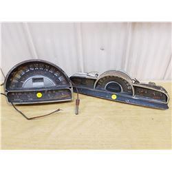 2 old vehicle speedometers