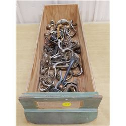 wooden drawer full of hooks #1