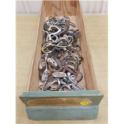 wooden drawer full of hooks #2