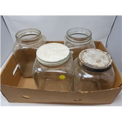 FOUR GLASS JARS (2 WITH LIDS)