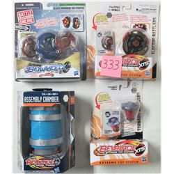 Lot 4 new Beyblade battlers & assembly chamber