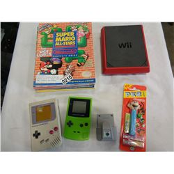6 NINTENDO PLAYERS GUIDES AND GAMEBOY COLOUR W/ DONKEY KONG GAME, GAMEBOY, N64 RUMBLE, WII, AND PEZ
