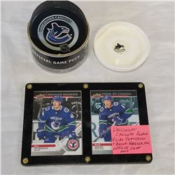 VANCOUVER CANUCKS ROOKIE ELIA PETTERSON AND BROCK BOESEN AND OFFICIAL GAME PUCK