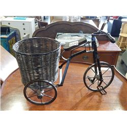 SMALL METAL AND WICKER TRICYCLE PLANTER