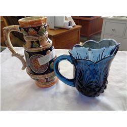 VINTAGE POTTERY PITCHER AND VINTAGE HEAVY BLUE GLASS PITCHER
