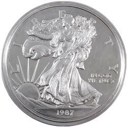 1987 USA 1 Pound Liberty .999 Fine Silver Coin. Contains 12oz (TAX Exempt). Capsule lightly scra