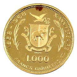 1970 Republic of Guinea 1000 Francs .900 Gold Coin in Pouch with COA. Contains 0.1157oz Fine Gold (t