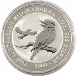 2004 Australia $5 1oz Kookaburra Fine Silver Coin in Capsule (lightly toned). Lowest mintage year of