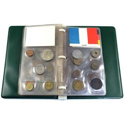 11x World Coin Sets in Plastic Pages Contained in a Small Green Binder. You will receive coin sets f