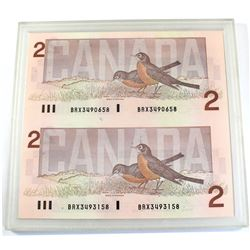 Pair of 1986 $2 BRX Replacement Notes S/N: BRX3490658 & 3493158. Both notes are UNC and come in hard