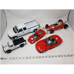 lot of toy vehicles (one is damaged, as is)