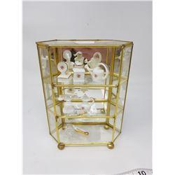 small curio case and collectibles