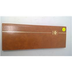 BROWN UNI SAFE STAMP BOOK WITH STAMPS