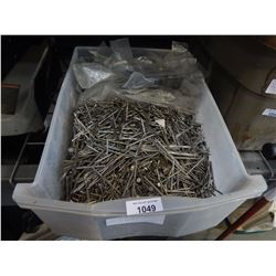 CLEAR BIN OF VARIOUS TYPES OF NAILS AND BRACKETS