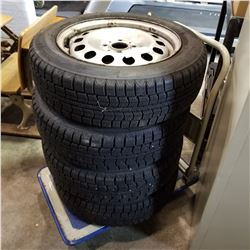 SET OF 4 175/ 65 R15 TIRES ON 4 BOLT RIMS