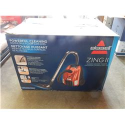 BISSELL ZING IT VACUUM - USED TWICE