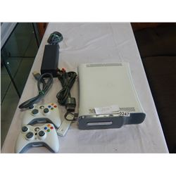 XBOX 360 CONSOLE WITH TWO CONTROLLERS AND CORDS